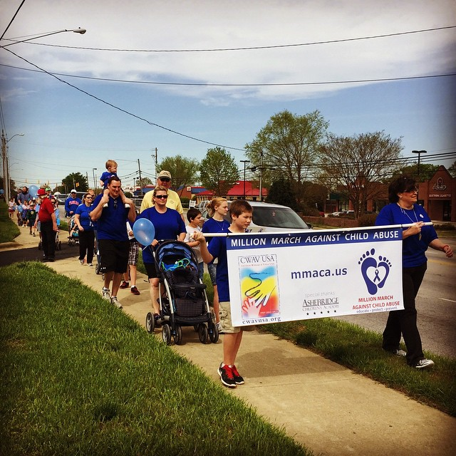 Teachers, parents and kids showing support in fight against child abuse at a Preschool & Daycare/Childcare Center serving Apex & Fuquay-Varina, NC