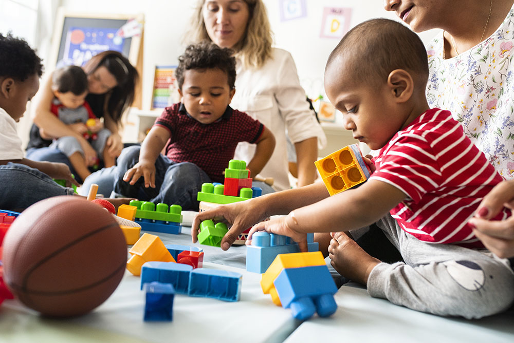Diverse children enjoying playing with toys at a Preschool & Daycare/Childcare Center serving Apex & Fuquay-Varina, NC