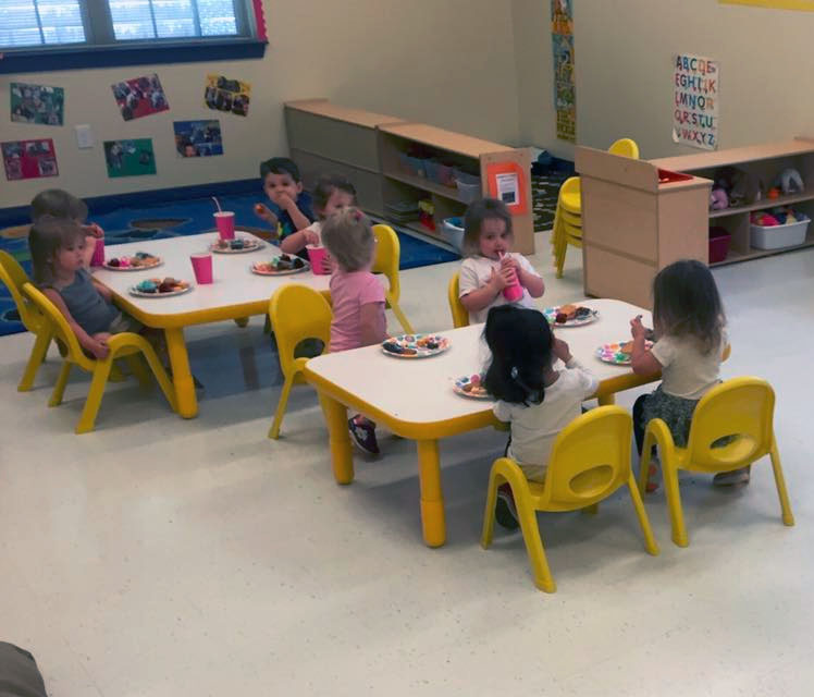 Group of little young ones having a meal, eating healthy foods at a Preschool & Daycare/Childcare Center serving Apex & Fuquay-Varina, NC