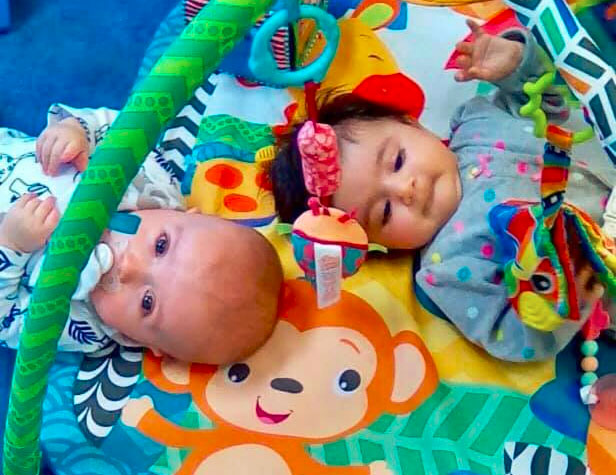 Adorable babies enjoy playing with educational toys at a Preschool & Daycare/Childcare Center serving Apex & Fuquay-Varina, NC