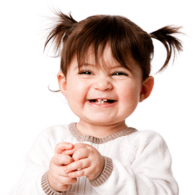 Cute little baby girl smiling at a Preschool & Daycare/Childcare Center serving Apex & Fuquay-Varina, NC