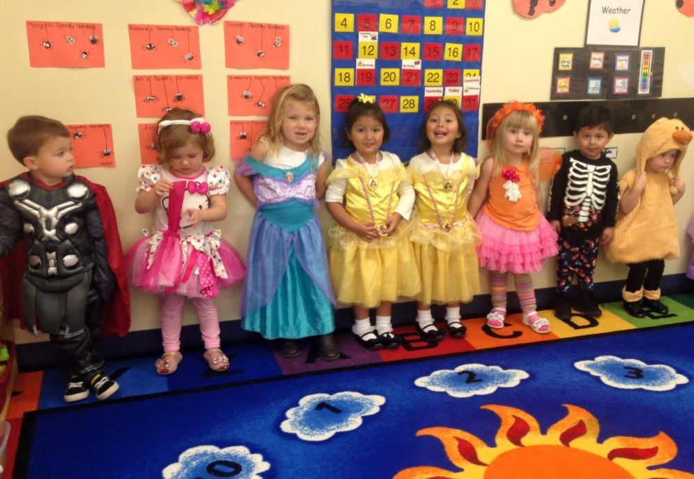 Happy group of kids wearing costumes, Thor costume, Disney princesses costume, skeleton costume at a Preschool & Daycare/Childcare Center serving Apex & Fuquay-Varina, NC