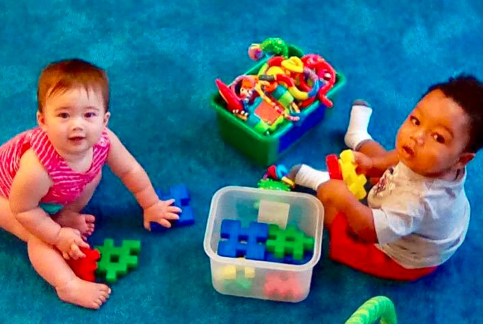 Toddlers playing with colorful educational toys at a Preschool & Daycare/Childcare Center serving Apex & Fuquay-Varina, NC