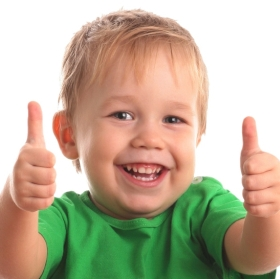 Happy young little kid boy , doing thumbs up, at a Preschool & Daycare/Childcare Center serving Apex & Fuquay-Varina, NC