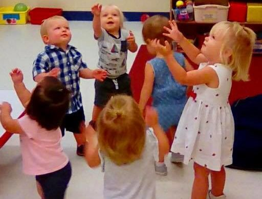 Group of kids enjoy playing inside the nursery room at a Preschool & Daycare/Childcare Center serving Apex & Fuquay-Varina, NC