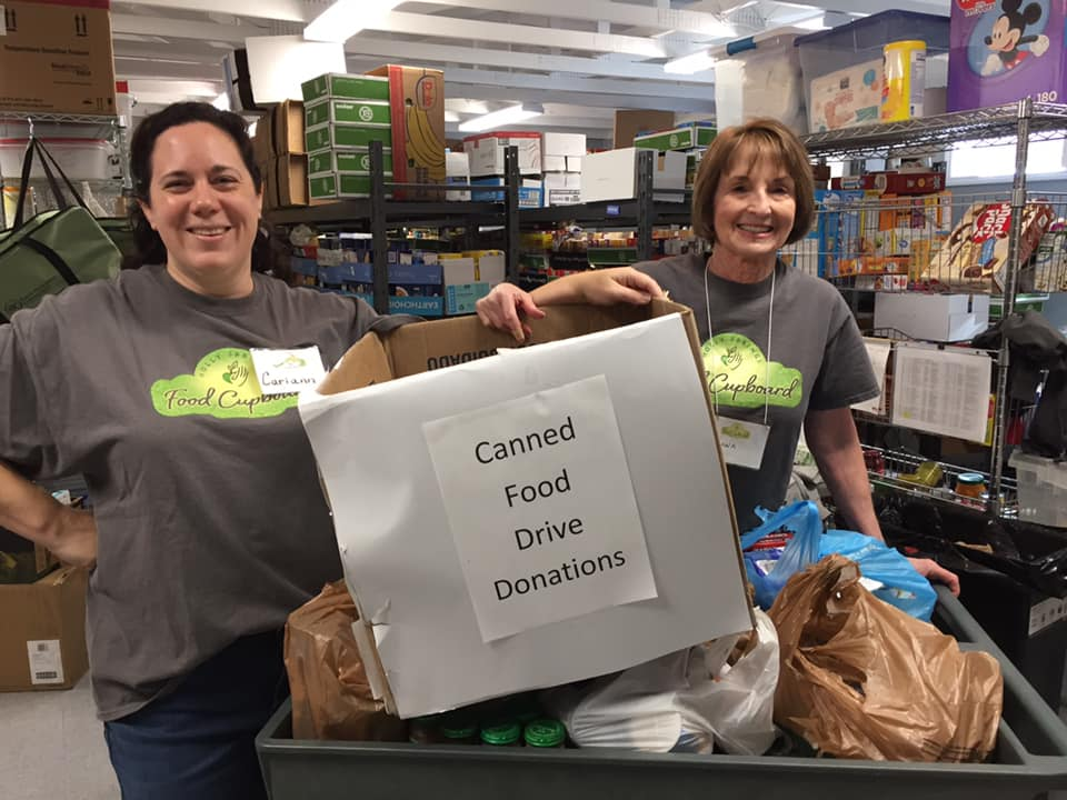 Teachers promoting Canned Food Drive Donations at a Preschool & Daycare/Childcare Center serving Apex & Fuquay-Varina, NC