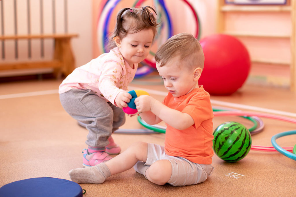 two little kids in sports room at a Preschool & Daycare/Childcare Center serving Apex & Fuquay-Varina, NC