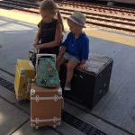 Kids beside luggage at a Preschool & Daycare/Childcare Center serving Apex & Fuquay-Varina, NC