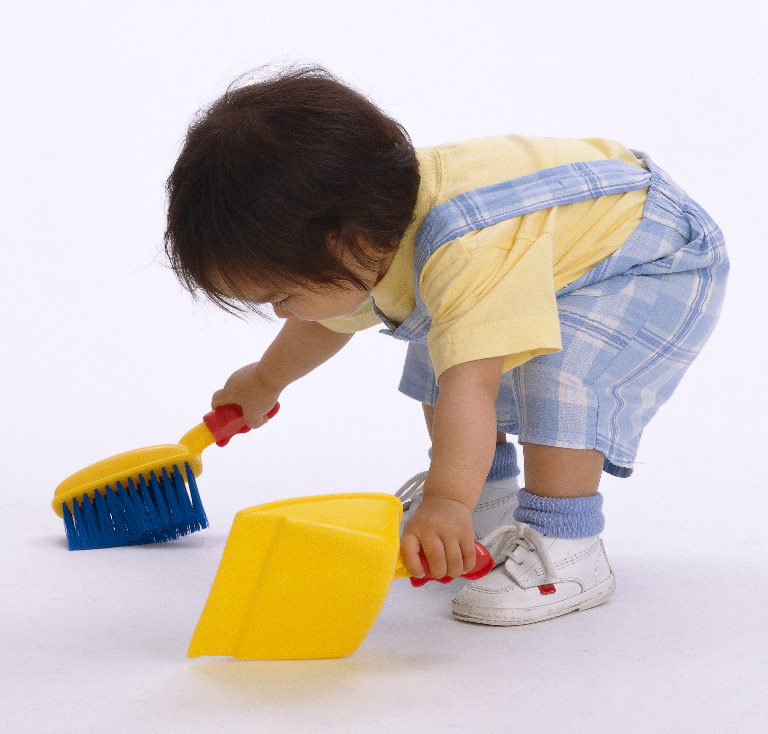Toddler doing house chores concept at a Preschool & Daycare/Childcare Center serving Apex & Fuquay-Varina, NC