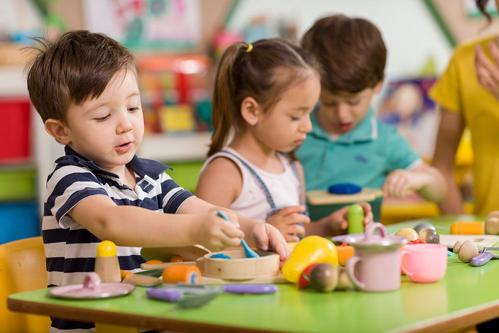 Preschool kids playing with nutritional toys at a Preschool & Daycare/Childcare Center serving Apex & Fuquay-Varina, NC