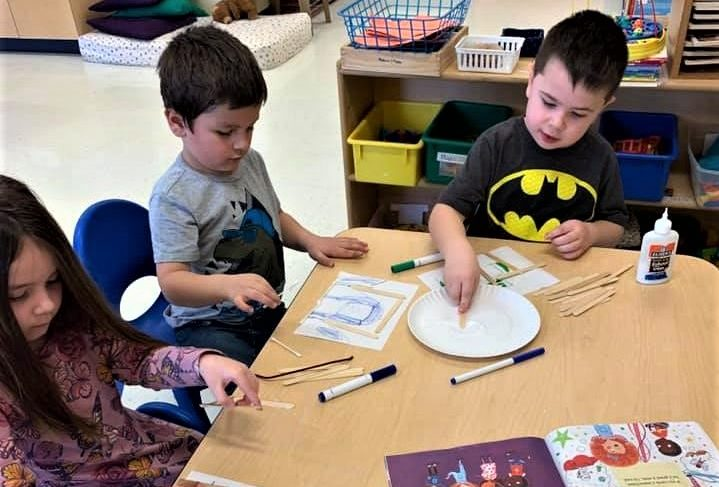 Preschool kids doing some art design , drawing, coloring, pasting at a Preschool & Daycare/Childcare Center serving Apex & Fuquay-Varina, NC