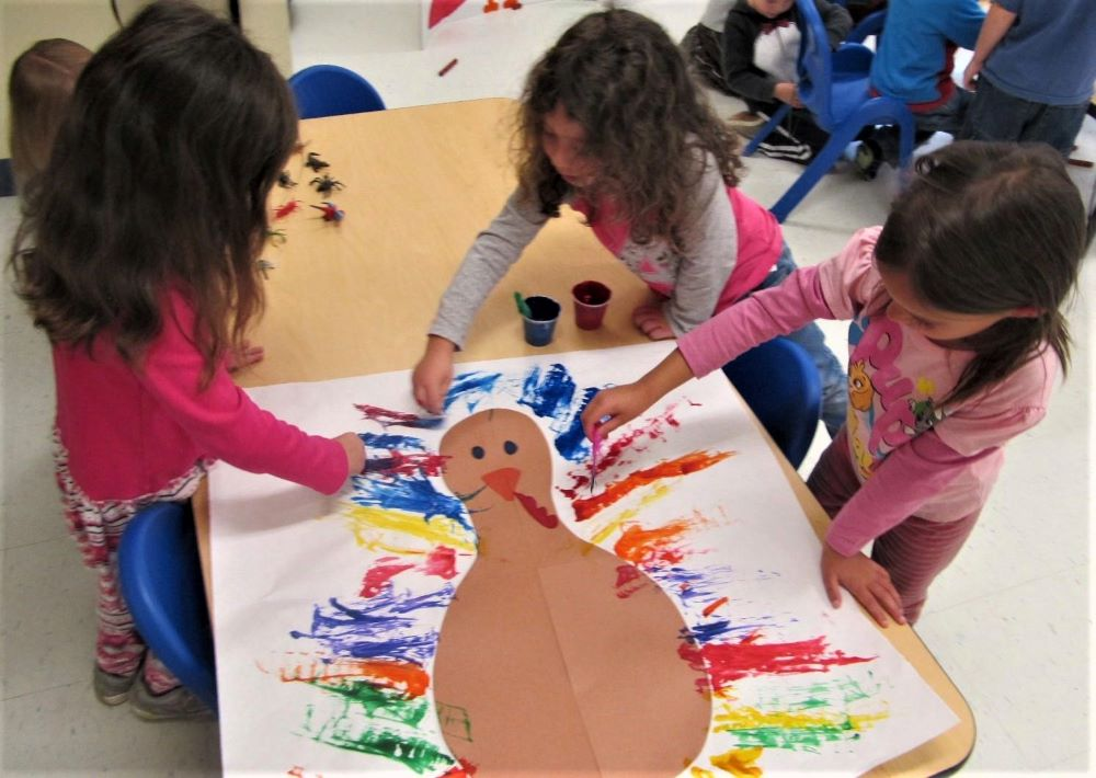 Young preschool girls showing artistry coloring and painting at a Preschool & Daycare/Childcare Center serving Apex & Fuquay-Varina, NC