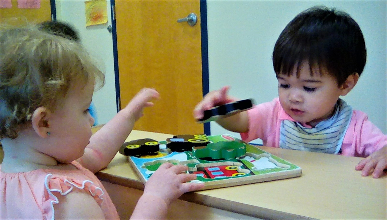 Toddlers on outstanding developmental activity, playing with educational building blocks at a Preschool & Daycare/Childcare Center serving Apex & Fuquay-Varina, NC