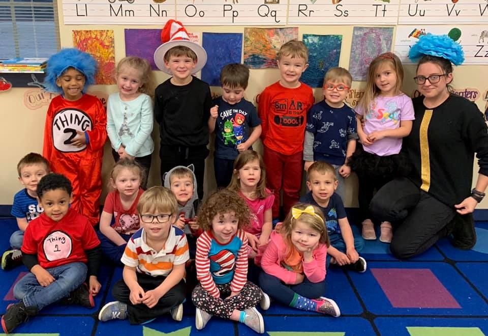 cherishing education, Happy teacher with preschoolers gather around at a Preschool & Daycare/Childcare Center serving Apex & Fuquay-Varina, NC