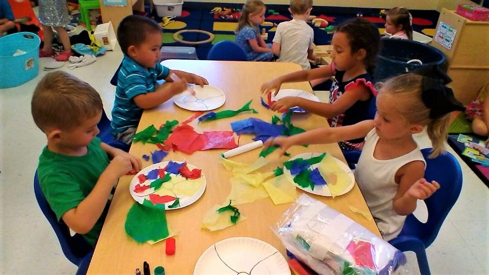 Preschool kids exploring creativity at a Preschool & Daycare/Childcare Center serving Apex & Fuquay-Varina, NC